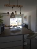 appartement-3-pieces-rive-gauche-coin-repas-vue-mer-thevenon-letsgrauduroi-5432